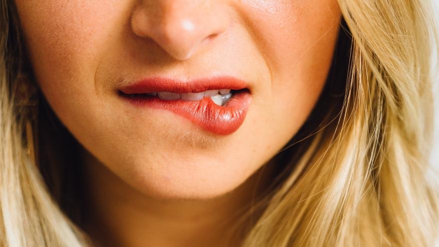 Woman biting her lower lip